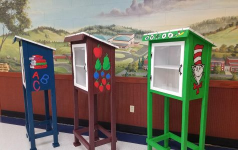 National Art Honors Society Members Paint Library Boxes For The Community